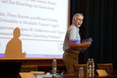 Eyjólfur Ingi Ásgeirsson, Magnús Halldórsson (on the picture) and Tigran Tonoyan receive ICALP Track C Best Paper Award